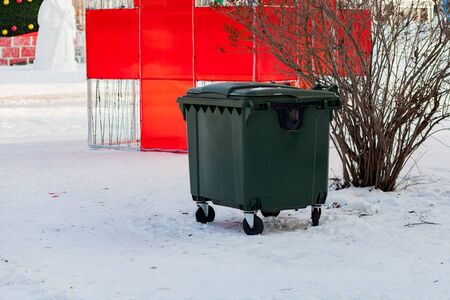 green recycling container in winter park. republic of bashkortostan. Russia
