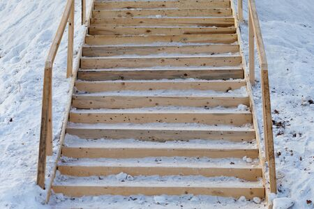 Wooden stairs on the winter hill. Russia