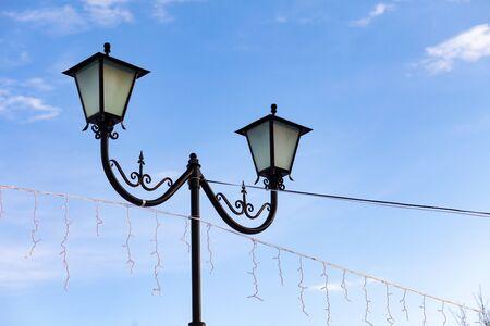 Beautiful lamp post in the park. Winter