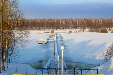View of snow covered piers on frozen Lake. republic of bashkortostan Russia