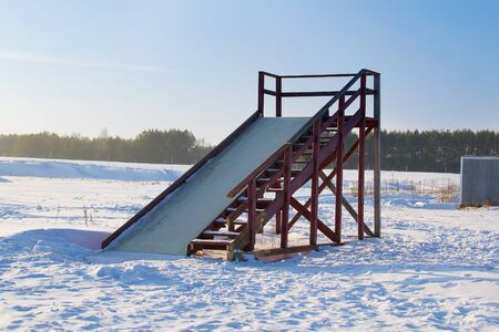 winter landscape in the forest. skiing on a wooden ice slides on inflatable wheels. Outdoor recreation in Russia