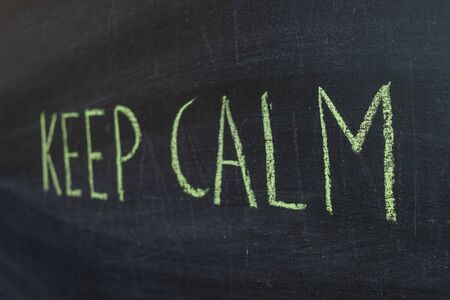 Keep calm text-green chalk text on the Board