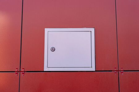 small hatch for electricians in the ventilated facade