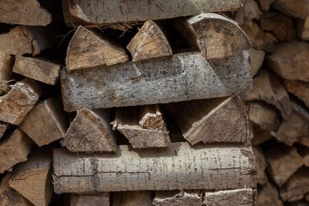 a pile of chopped wood. Woodpile with firewood