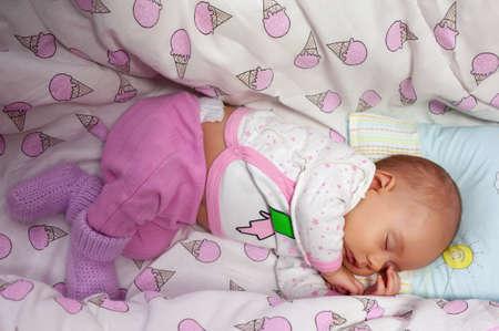 baby sleeps in the crib