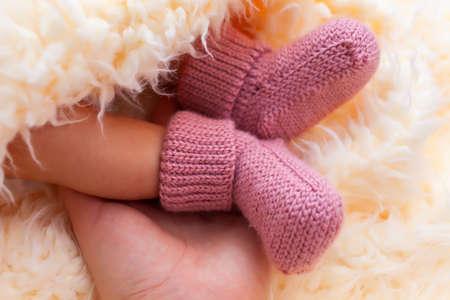 newborn's feet in wool socks