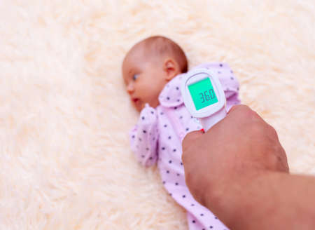 Measuring the temperature of a newborn baby using an infrared thermometer
