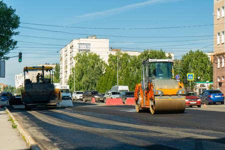 08/12/2020 Ufa, Bashkortostan: Repair of the road surface on Dostoevsky street. Equipment for laying asphalt.