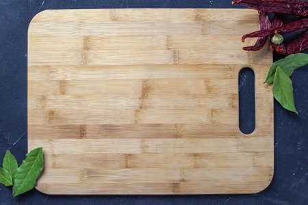 Cutting Board on a dark background. The view from the top