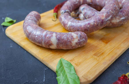 Fresh homemade sausage rings on a cutting Board