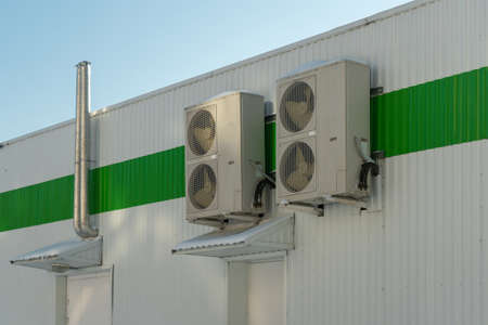 Industrial air conditioner on the building facade