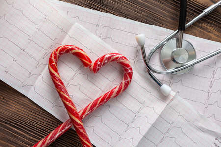 Heart with a stethoscope on a paper cardiogram.
