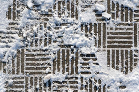 Texture of paving slabs in winter, top view