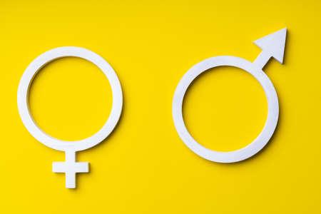 Symbols of Mars and Venus on a yellow background. Gender symbols of woman and man 版權商用圖片
