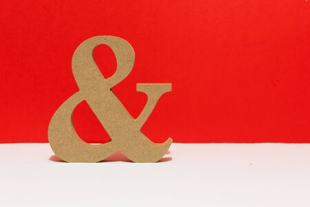 Wooden letter, and sign, red background. Metaphorical for couples love and being together for ever.