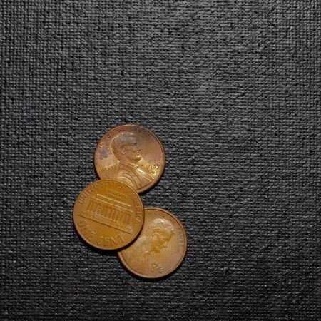three pennies, US currency, one cent coins. isolated on black bacground. 1x1