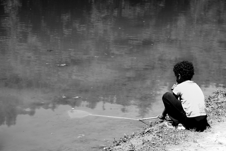 fishman: Boy on the lake
