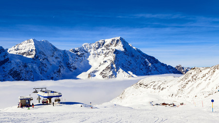 chairlift: amazing mountain view on the alps Stock Photo