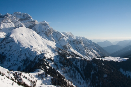 ski traces: View of Dolomite of Brenta towards Cima tosa in Italian Alps mountain with ski traces in the snow under it.