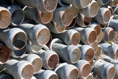 Pila de tubos de riego de cinc con final r?pido acoplamiento de cierre Foto de archivo - 17931982