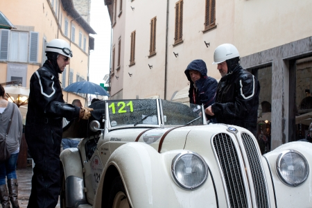 mille: Mille Miglia 2013, Sansepolcro. an old racing car Bmw 328 (1938) runs under the rain in rally Mille Miglia 2013, re-enactment of the old italian endurance race (1927-1957) Editorial