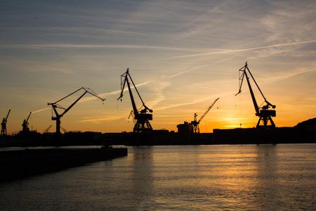 helena: Harbor cranes at sunset. Image taken in Gothenburg, Sweden