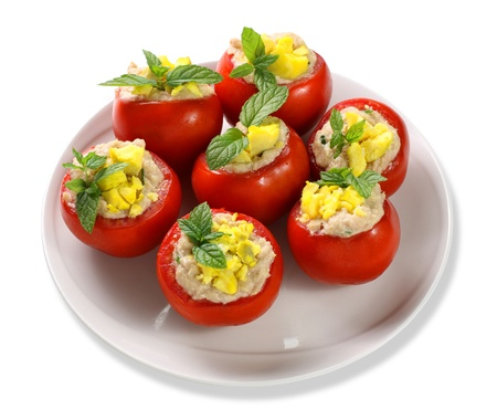 tomato cocktail: Tomatoes stuffed with eggs, tuna and cocktail sauce on white