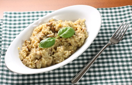 Risotto with mushrooms on table photo