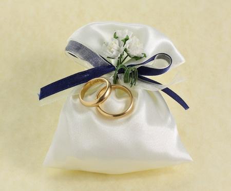 Wedding rings on background photo