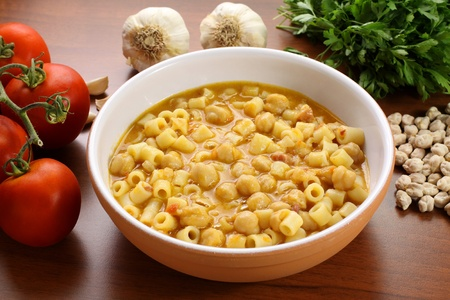 Pasta with chickpeas on wooden table photo
