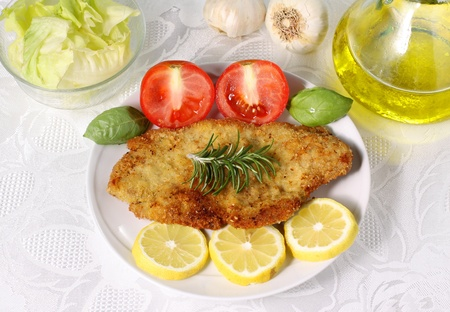 Cutlet meat on dish photo