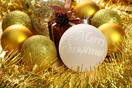 Christmas decorations: Golden balls and tapes photo