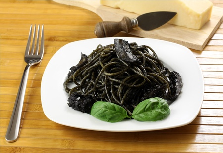 sicilian: Pasta with squid ink on wooden table Stock Photo