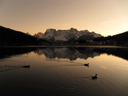 mount sorapiss reflects itself on the misurina lake, in the heart of dolomites  photo