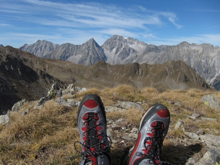 beetwen: Mt Regelspitze, South Tyrol, ITALY - September  29, 2011: Some moments of relax on the top of Mt Regelspitze, after more than 4 hours of trekking in a special wild environment beetwen Italy and Austria. The shoes are from LaSportiva collection. Editorial