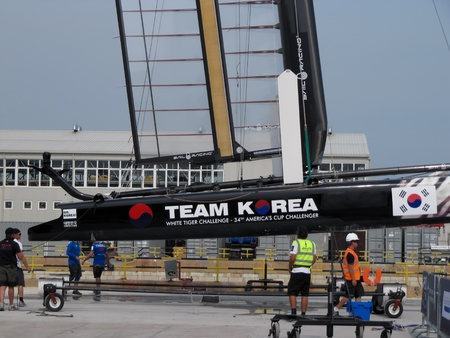 Venice, ITALY - May 11, 2012: Team Korea AC45 catamaran in the team bases area is going to be moved in the sea for tests during the ACWS Stock Photo - 13669128