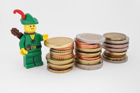 robin hood: Venice, Italy - October 23, 2014: Robin Hood standing next to European euro coins Editorial