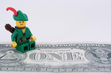 robin hood: Venice, Italy - October 23, 2014: Robin Hood standing on  an American one dollar bill