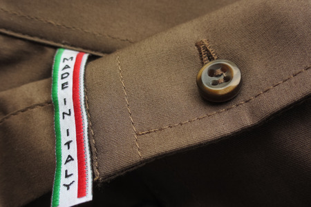 Made in Italy label on brown cotton shirt Stok Fotoğraf