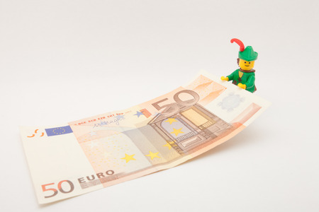 50 euro: Venice, Italy - November 27 - 2014: Robin Hood (as Lego figure) keeping a 50 euro bill