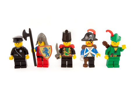 Venice, Italy - December 12, 2014: Lego figures from 80's standing on  white background, December 12, 2014 in Venice, Italy Editöryel