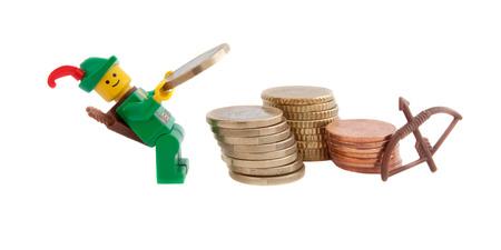 robin hood: Venice, Italy - December 27, 2014 - Robin Hood (as Lego figures) standing next to European euro coins