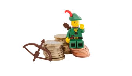 Venice, Italy - December 27, 2014 - Robin Hood (as Lego figures) standing next to European euro coins