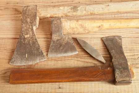 dated: Three dated and used cleavers on wooden background