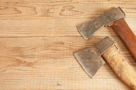 dated: Two dated and used cleavers on wooden background