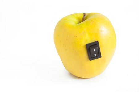 bioengineering: Single yellow apple with switch in power off position