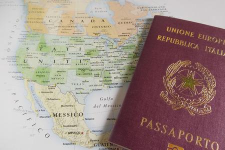 Italian passport over USA map Banco de Imagens
