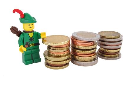 robin hood: Venice Italy October 23 2014 Robin Hood as Lego figures standing next to European euro coins Editorial