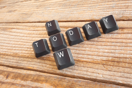 today: TODAY NOW wrote with keyboard keys on wooden background