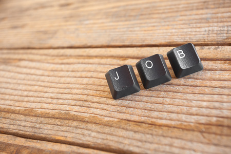 wrote: JOB wrote with keyboard keys on wooden background